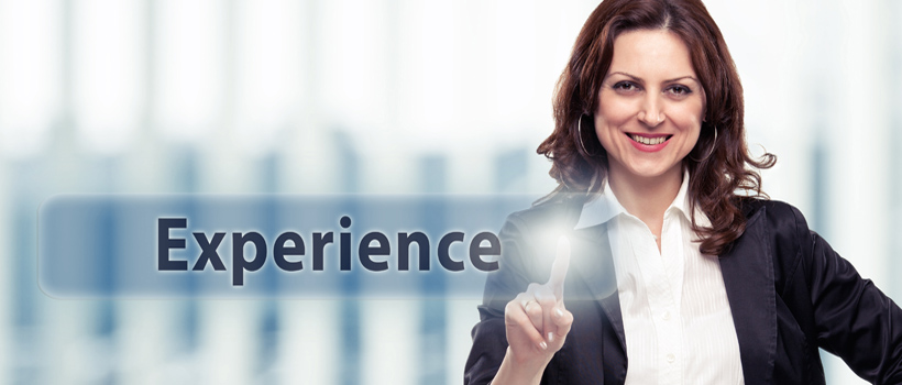 Middle-aged Business woman pressing experience button. Experience concept, toned photo.